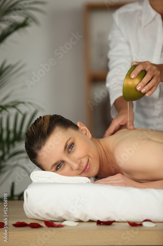beautiful woman being massaged