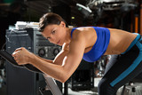 Aerobics spinning monitor trainer woman at gym