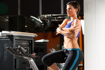 Aerobics spinning monitor trainer woman stretching