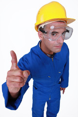 Manual worker with a finger up.