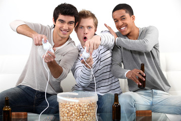 Teenagers playing video games.