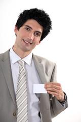 Businessman confidently presenting card