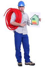 Electrician holding energy rating placard