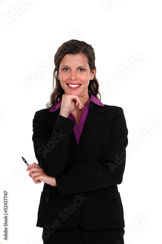 Pensive businesswoman holding pen