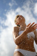 Attractive woman splashing in the water