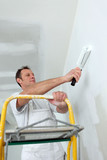 Man redecorating his house