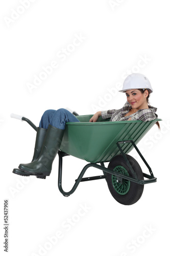 Woman laying in wheelbarrow