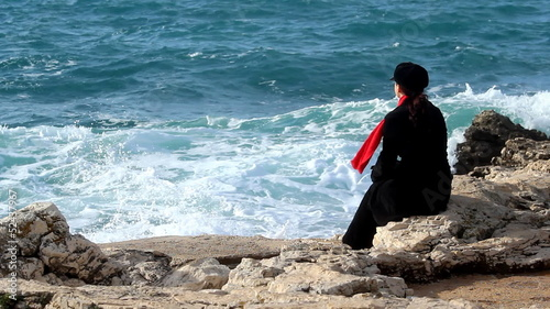 Sea, red scarf and wind