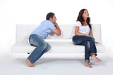 Man apolgising to woman on couch
