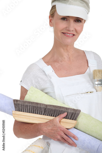 Woman preparing to wallpaper