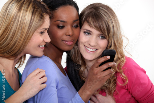 Girlfriends with a mobile phone