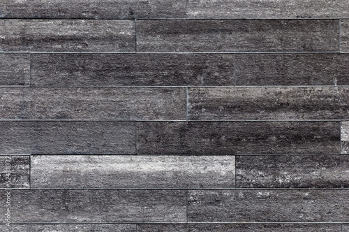 Grey grunge tile wall background and texture.