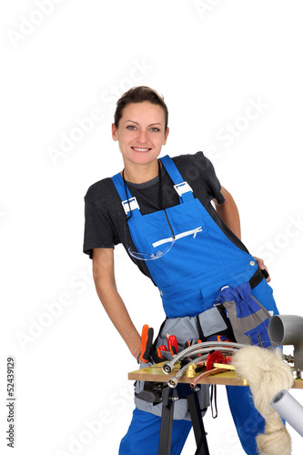 woman plumber behind table