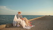 Retired woman relaxing with book at seaside