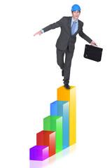 Businessman balancing on bar chart