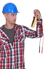 Electrician holding multimeter