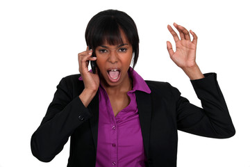 Businesswoman furious over the phone.