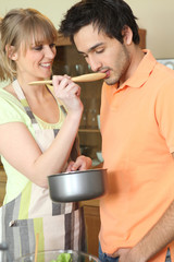young woman and companion tasting dish