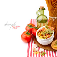 Italian pasta and vegetables on wooden board