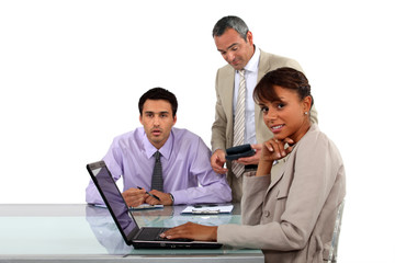 Three business people in meeting