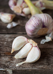 Segments of Garlic on the Wooden Table, selective focus