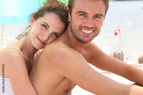 Affection couple relaxing at the beach