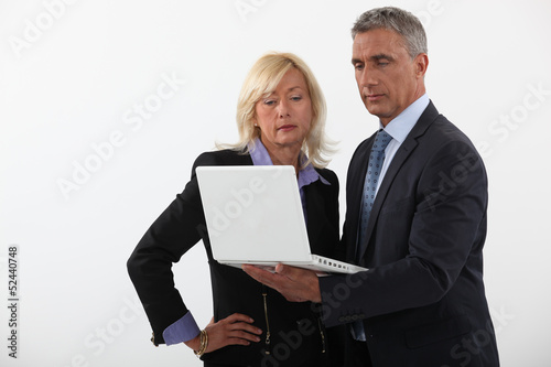 Businesspeople reading a report