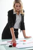 businesswoman analyzing statistics