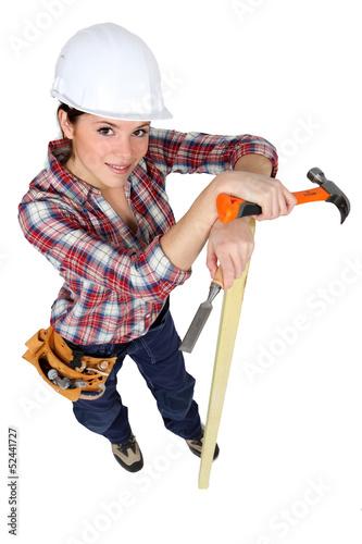 Woman carpenter, studio shot