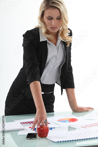 businesswoman analyzing statistics