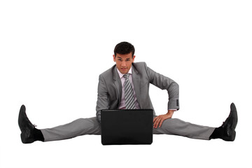businessman side splitting on the floor