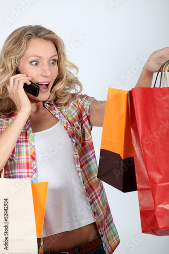 enthusiastic woman after shopping frenzy