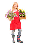 Full length portrait of a middle aged female florist holding flo