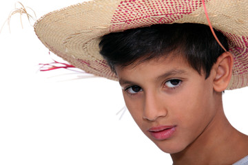 Portrait of boy with big hat