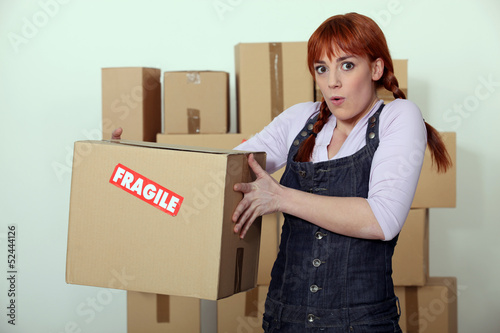 Woman carrying fragile box