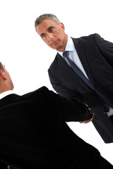 Smart businessmen handshaking