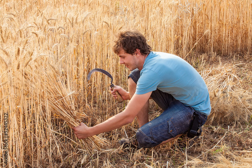 Portrait of smile farmer with sickle