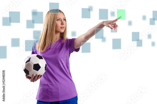 Woman with football pressing virtual buttons