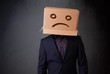 Young man with a brown cardboard box on his head with sad face