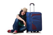 Young woman with suitcase isolated on white