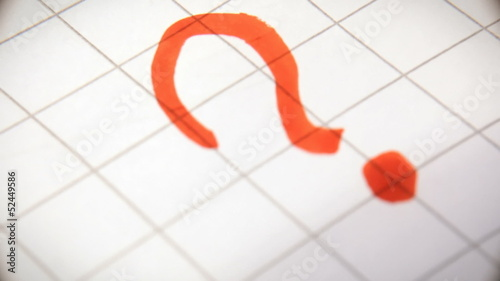 Hand drawing punctuation marks on paper macro