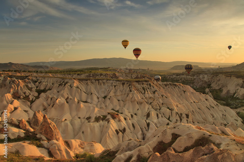 Plexiglas Ballon Hot air balloon flying over rock landscape at Cappadocia Turkey