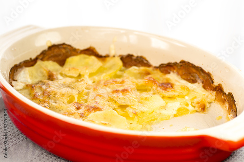 baked potatoes in a porcelain pan