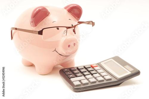 Leinwanddruck Bild Pink Piggy Bank With Calculator
