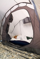 Girl sleeping in a tent