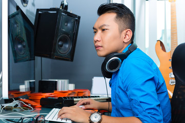 Indonesian man in recording studio