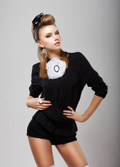 Individuality. Stylish Woman in Black Shorts and Blouse. Fashion