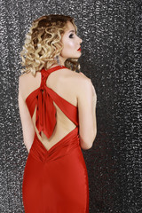 Elegance. Fashion Woman in Red Prom  Dress. Rear View