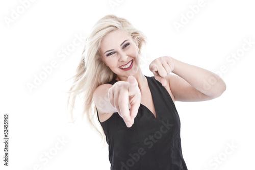 Spaß und Freude - Blonde Frau isoliert zeigt mit dem Finger