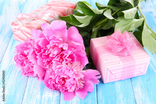 Beautiful peonies on table close-up
